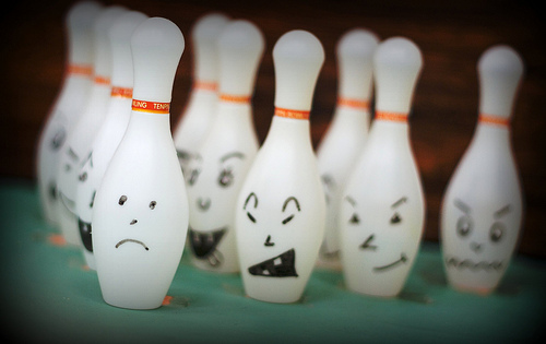 bowling pins with unhappy faces