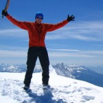 Triumphant guy on top of a mountain