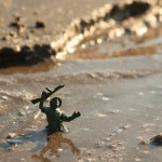 a small toy soldier is stuck in quicksand