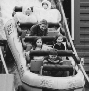children on a water ride demonstrate different reactions to fear