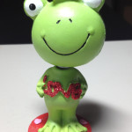 frog prince bobble-head toy